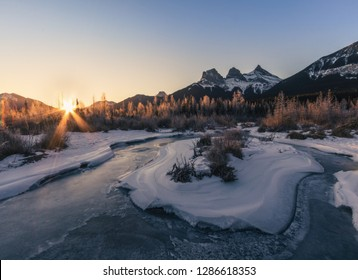 Freezing morning at the Cougar creek with a beautiful view on the Three Sisters mountains, Canmore, Travel Alberta, Canada, North America
