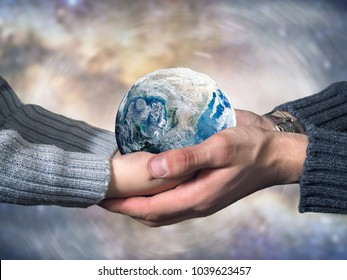 Freezing planet Earth. Hands of an adult and a child. The concept of climate change, ice age, abnormal weather on the planet