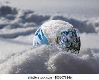 Freezing planet Earth. Large drifts of snow. The concept of climate change, ice age, abnormal weather on the planet