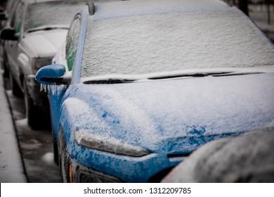 freezing rain ice coated car.  Frozen car. Bad driving weather in freezing rain.