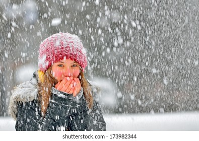 freezing young woman warming his hands