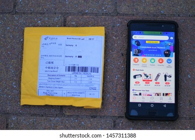 Freiberg Germany - July 21 2019 aliexpress shopping app with a post from china