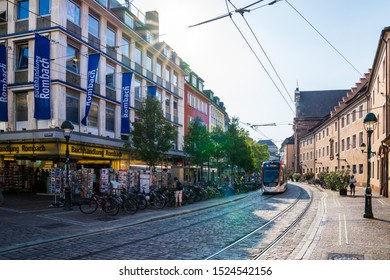 Freiburg im breisgau, Germany, August 30, 2019, Inner city view at bookstore with countless bikes parking next to tramway rails on sunny day near the theatre