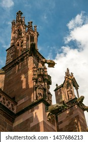 FREIBURG IM BREISGAU, GERMANY - JUNE 15, 2019: Freiburg Minster is the cathedral of Freiburg. It was begun in Romanesque style and finished in Gothic style. Waterspouts and other statuary