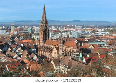 Freiburg im Breisgau, Germany. View over Freiburg Minster from slope of Schlossberg Hill. The cathedral was founded around 1200 and completed in 1330. It has remained largely intact in World War II.