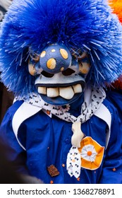 Freie Strasse, Basel, Switzerland - March 12th, 2019. Close-up of a blue grinning carnival waggis mask