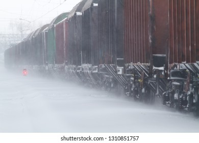 freight cars go by rail in a snowstorm