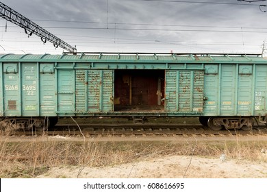 Freight cars. The railway. Train. Wagon with open doors.