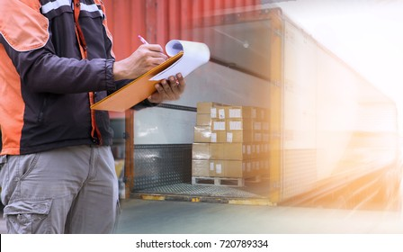 Freight industry logistics and transportation, Warehouse worker holding clipboard inspecting details checklist of cargo, shipment load with truck container.