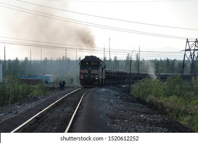 A freight train carries iron ore from a mine, Norilsk, Russia.