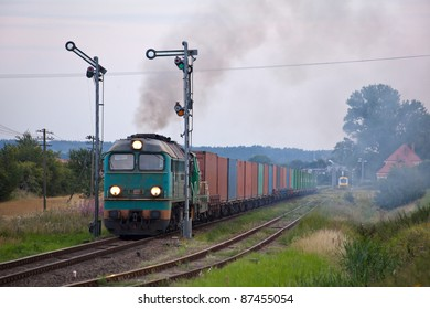 Freight train hauled by the diesel locomotives starting from the station