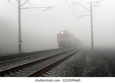 Freight train leaves the fog