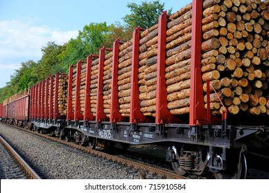 Freight train loaded with pine trunks