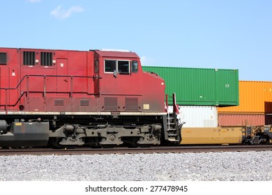 Freight train locomotive and cargo containers