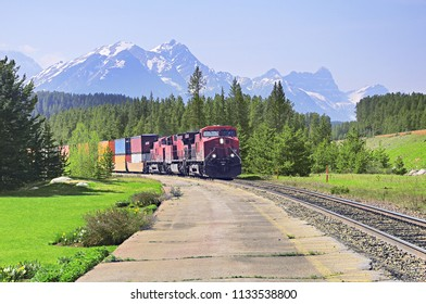 Freight train moves from Vancouver to Calgary. Lake Louise station. Canada.