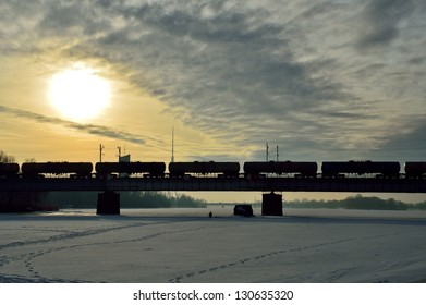 Freight train on the bridge during the sunrise