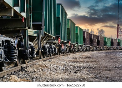 The freight train passes by the station. Wagons with goods delivery.