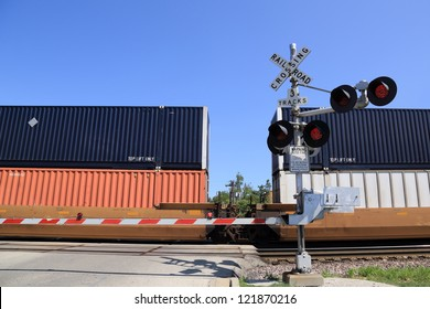 Freight train at railroad crossing gate