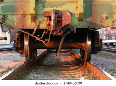 Freight train. Rear view of the last wagon of a freight train at a railway station at sunset. Close-up.