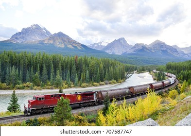 Freight train running in Canadian Rockies in Autumn, Canadian Rockies