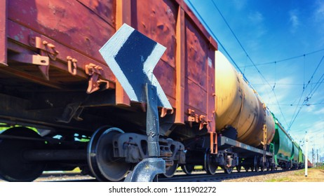 The freight train rushes past the arrow