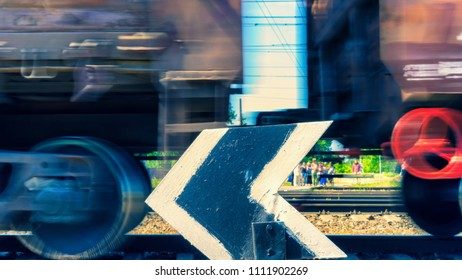 The freight train rushes past people