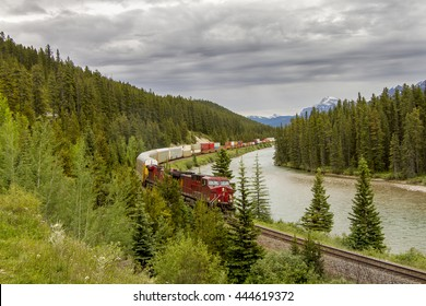 A freight train travels through the Bow Valley - Banff National Park, Alberta, Canada