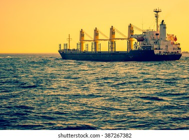 Freight transport - cargo ship sailing at sea. Cargo vessel - maritime transport and logistic industry in global business.