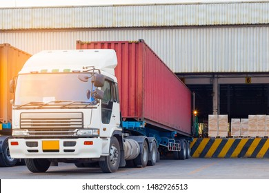 Freight transportation and warehouse logistics, trucks trailer docking at warehouse, cargo pallets shipment for loading into a truck.