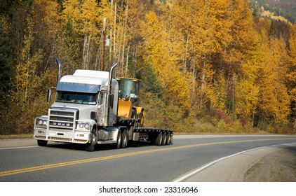 Freight truck passing Canadian highway