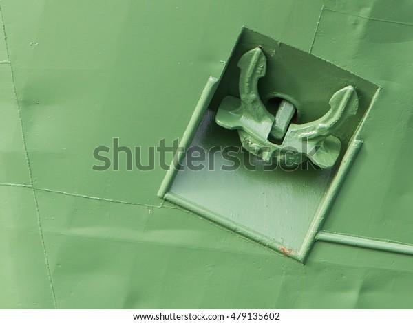 Freighter anchored on - Selective focus - Green ship