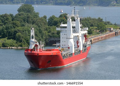 a freighter has passed the sluice of Kiel Holtenau