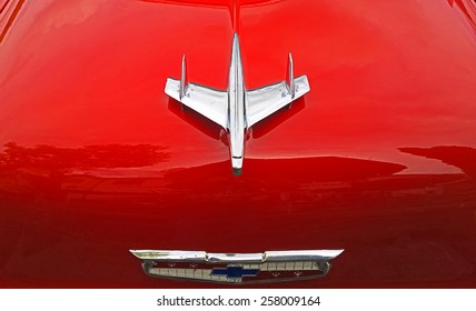 FREISING, GERMANY - AUGUST 1, 2014 Shiny red vintage Chevrolet car hood with airplane logo