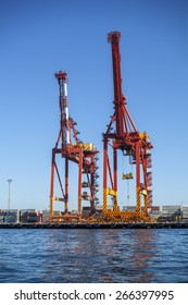 FREMANTLE, AUSTRALIA, 29 MARCH, 2015: Two Post-Panamax cranes in the Fremantle Inner Harbour. The cranes were manufactured in Shanghai and delivered fully assembled to Fremantle, Melbourne and Sydney.