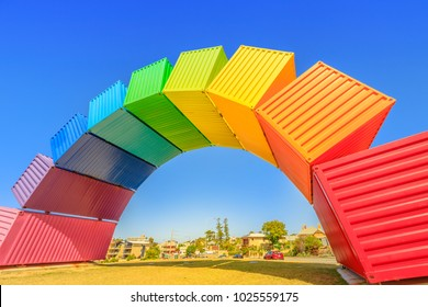 Fremantle, Australia - Jan 7, 2018: Fremantle travel welcome. Rainbow Sea Container in Fremantle Port near Perth, Western Australia. Homosexuality and hope concept. Blue sky. Copy space.