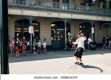 Fremantle, Perth, Australia - Dec 17 2017 - Street juggler perform and entertain the crowd at alley outside the popular Fremantle Markets.