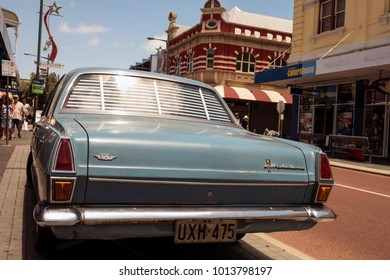 Fremantle, Perth, Australia - Dec 17 2017: A nice muted blue color classic holden park by road side.