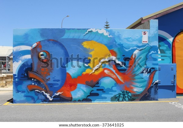FREMANTLE, WESTERN AUSTRALIA - November 16, 2015. Multi color street art and mural painting of a big fish on the wall in the harbor. Suburb of Perth.