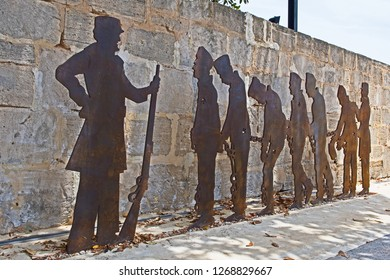 Fremantle, Western Australia/Australia - December 27 2018: a bronze sculpture depicts convicts being taken in chains and under guard to the Fremantle prison.