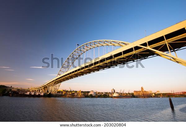 Fremont Bridge with the largest arch in America Portland Oregon Willamette River. The bridge was built across the navigable river. Elegant arched bridge - modern engineering industrial landmark.