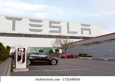 Fremont, CA - January 25, 2020: Tesla model S charging at supercharger station at Tesla factory in Fremont, the only Tesla factory in USA