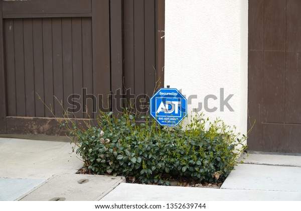 Fremont, CA / United States - March 27, 2019 - ADT Security Sign in front of a home.