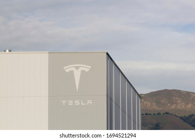 Fremont, CA, USA - Feb 28, 2020: The Tesla sign seen at Tesla Factory in Fremont, California. Tesla, Inc., is an American electric vehicle and clean energy company based in Palo Alto, California.