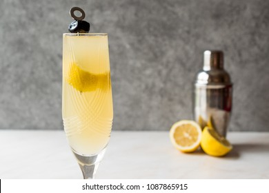 French 75 Champagne Cocktail with Lemon Peel and Black Olive