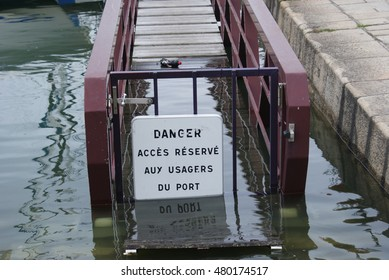 French access sign in water