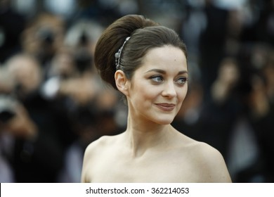 French actress Marion Cotillard leaves after the screening of 'De Rouille et D'Os' (Rust and Bone) presented in competition at the 65th Cannes film festival on May 17, 2012 in Cannes.