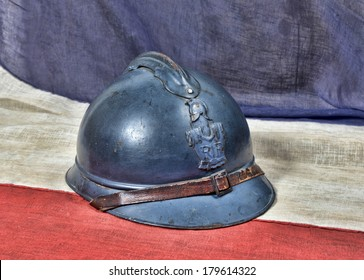 french Adrian ww1 helmet on the french antique flage