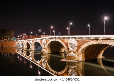 French ancient town Toulouse and Garonne river panoramic night view. Toulouse is the capital of Haute Garonne department and Occitanie region, France, South Europe. Famous tourist destionation.
