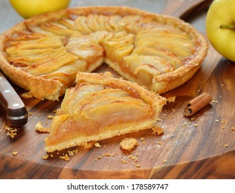 French apple tart on a brown background
