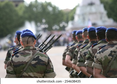 A french armed marching soldier